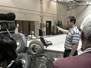 Photo: SLOPE employee shows off a collection of rover wheel prototypes.