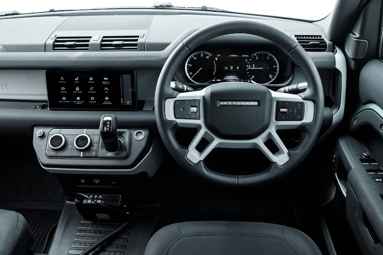 The modern digitised interior is a far cry from the old Defender's. Picture: SUPPLIED