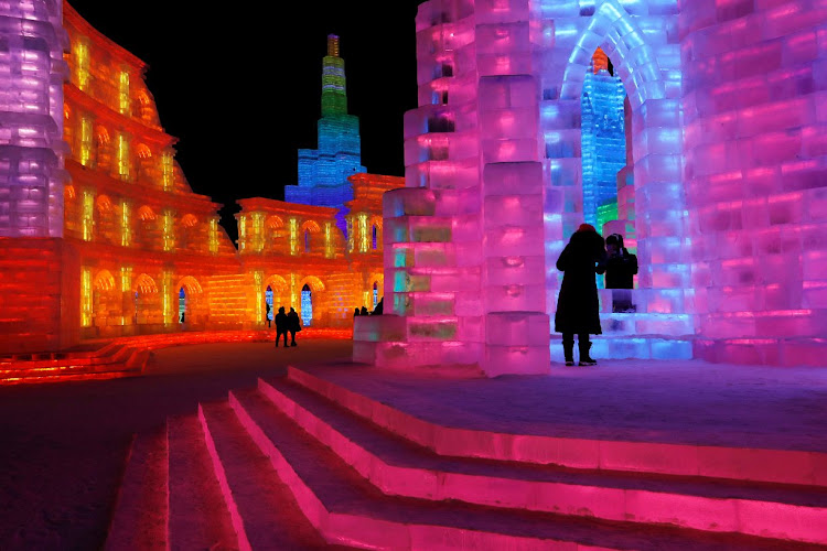 Ice sculptures illuminated by coloured lights at the annual ice festival in the northern China city of Harbin.