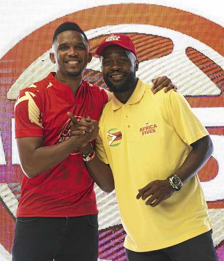Castle five-a-side ambassador Samuel Eto'o and Tinashe Nengomasha at the launch yesterday.