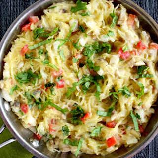 Spaghetti Squash With Basil and Creamy Cauliflower Alfredo Sauce [Vegan].