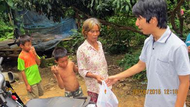 Photo: Baan Pang Mo village near Chiang Dao.  Grandmother and grandsons with Arm.