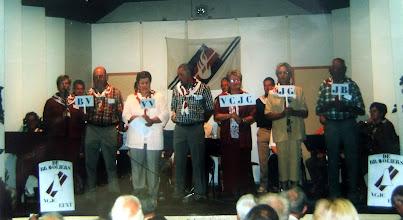 Photo: VCJC commissie 2004 v.l.n.r. Jannie Reitsema-Kruit, Berend Raterink, Jantje Rubing-Vedder, Jans Oosting, Aaltje Talens-Moek, Lammie Talens-Enting en Hendrik Hoving. BV = Bosvolk VV = Vrije Vogels VCJC = Vrijzinnige Christelijke Jeugd Vereniging JG JB