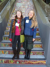 "Photo: Photograph by Robert Meli: Project artists Aileen Barr (left) and Colette Crutcher standing on the Hidden Garden Steps (16th Avenue, between Kirkham and Lawton streets in San Francisco's Inner Sunset District) shortly after the ribbon-cutting on the day of the opening celebration (Saturday, December 7, 2013) for the Steps; the artists' ""signature"" on the mosaic is playfully built into the earthworm on the bottom step.  For more information about the Steps, please visit our website (http://hiddengardensteps.org), view links about the project from our Scoopit! site (http://www.scoop.it/t/hidden-garden-steps), or follow our social media presence on Twitter (https://twitter.com/GardenSteps), Facebook (https://www.facebook.com/pages/Hidden-Garden-Steps/288064457924739) and many others."
