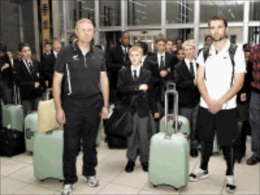WELCOME: The New Zealand team after their arrival at the OR Tambo International Airport yesterday morning are greeted by the Drakensberg Boys Choir. Head coach Ricki Herbert and captain Tim Brown pose for the media. Pic. Chris Ricco. 04/06/2009. © Backpagepix The New Zealand team arrived in South Africa this morning and were greeted by the Drakensberg boys choir. Head coach Ricki Herbert and captain Tim Brown pose for a picture with the Drakensberg Boys Choir.  ©Chris Ricco/Backpagepix.