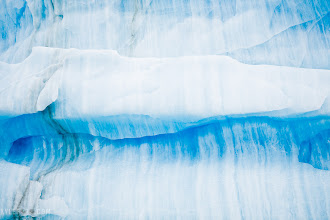 Photo: 90 Degree iceberg Canadian Arctic From the kylefoto of the day at http://www.kylefoto.com  What am I talking about with this 90 degree iceberg? I'm not talking about temperature, I'm talking about angles.  Look at the striations on the iceberg, how the lines in the ice are going straight up and down. Those are the layers of snow that have been compacted into ice while this ice was still being formed on a mountainside as a glacier. Over hundreds, even thousands of years each layer of snow is piled on top of each other until the tremendous pressure compresses it into ice.  Because the ice normally stays more or less upright while it's still a glacier, these lines should normally be horizontal. Once the glacier ends up dumping itself into the ocean the ice will bob around, melt, break apart, and in doing so this newly formed iceberg will rotate and change orientation. Thus the ice is now shifted 90 degrees from it's original orientation.  Now go into my master collection of photos and look at every other iceberg and you will obsessively look at these striations and assess the history of the iceberg, you will never be able to unsee it, muahaha!  Photographic details: Nothing special is going on here for camera settings, I was more looking for unique and interesting shapes and this one caught my eye. Sometimes I don't look at a subject as a whole and I just focus on the interesting detailed portions.  1/160s f/5.0 ISO50 170mm