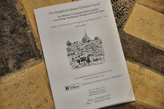 Photo: A liturgy with English translation for the foreign visitors.