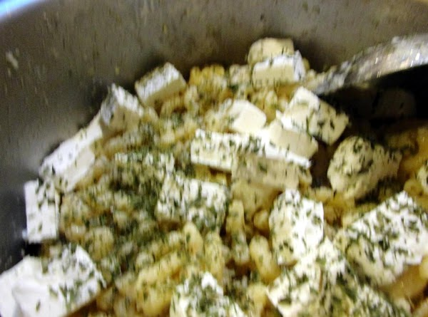 Add cubed cream cheese, shredded parmesan & parsley, then stir to combine.