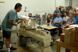 Photo: Mark bends over at this lathe but at home he cuts the wood at about shoulder height to save his back.