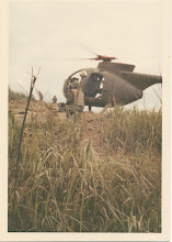 Photo: LOACH helicopter on LZ Peanuts.  Loading just upslope from FDC.  Possibly May 4, 1968.