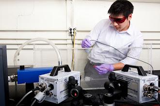 Photo: Paul is studying tethered beetle cyborg flight using PIV system. Photo taken by Evan Rosen