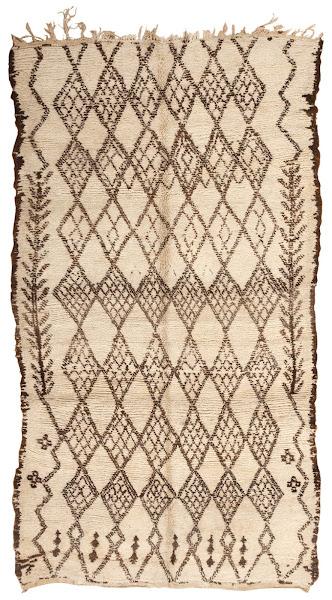 Photo: Moroccan Rugs http://nazmiyalantiquerugs.com/antique-rugs/moroccan-rugs-vintage-carpets/