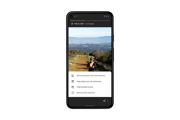 """A smartphone shows an image in Google Photos of a woman running on a mountain trail – below are controls that let the user hide specific images and people in the app's """"Memories"""" settings"""