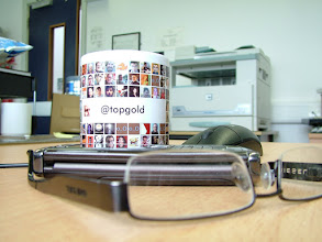 Photo: Broken glasses, old (durable) phone, stupid mouse and MY MUG.