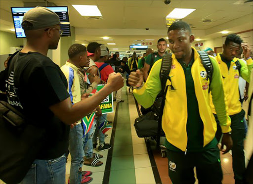 TOUCH DOWN: Bafana Bafana players were greeted by fans at the East London airport today. Picture: SINO MAJANGAZA