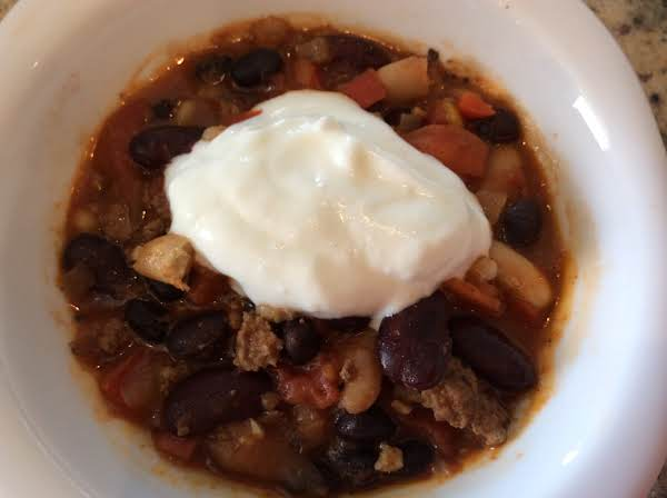 Chili Topped With A Spoon Of Yogurt.