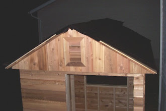 Photo: Once the plywood was nailed down, my brother and I worked to add roof felt (tar paper) to the roof. This will help add a little insulation and protect the roof from leaks.