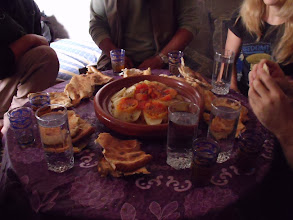 Photo: Eating tagine with bread: rather than using cutlery, you tear off a bit of bread and use that to mush the tagine and grab a bite's worth.