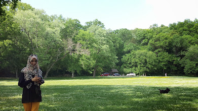Photo: the park was so green and lovely! here Zahra tries to avoid the doggie