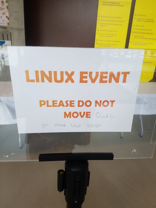 Printed: LINUX EVENT Please Do Not Move Handwritten: quickly or make loud noises