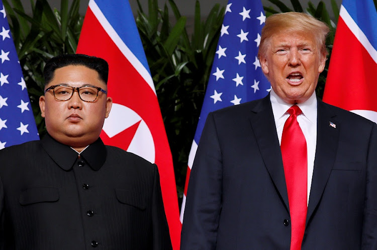 North Korean leader Kim Jong-un and US President Donald Trump at the Capella Hotel on Sentosa island in Singapore on June 12 2018. Picture: REUTERS/JONATHAN ERNST