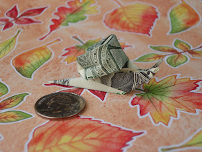 Photo: Model: Dollar Snail;  Creator: Margaret Van Sicklen;  Folder: William Sattler;  1 dollar;  Publication: The Joy Of Origami (Margaret Van Sicklen) ISBN 0-7611-3988-5