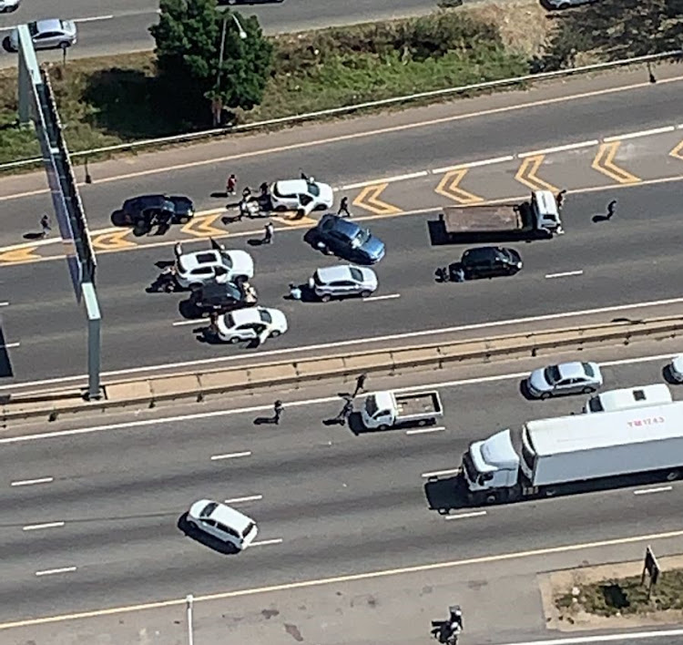 The crime scene on the M1 highway near the Woodmead exit in Johannesburg on Monday after a shoot-out between law enforcement and a gang of armed robbers.