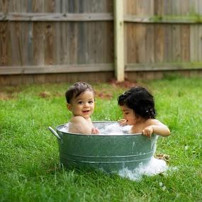 Tubby Time by A. Caracciolo - Babies & Children Babies ( bathtub, green, bath, tub, bubbles, twins, outside, baby, babies, cute baby, cute )