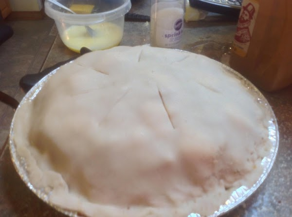 Cover with top crust, sealing the top crust to the bottom crust. Then flute...
