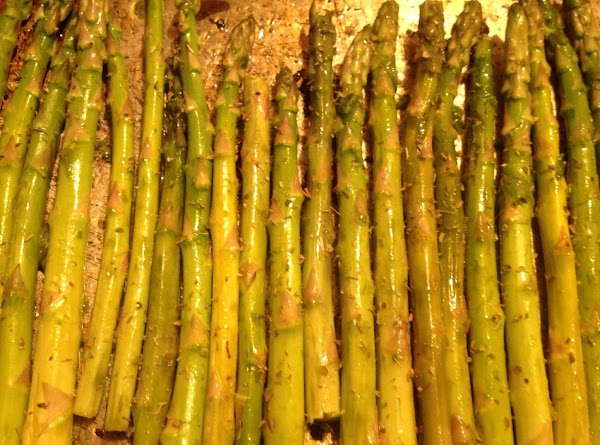 Preheat oven 375F. Rinse Asparagus, cut white stems off. Align in baking pan.