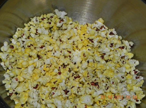 Mix well with your hands the popcorn and ranch butter mix in a bowl....