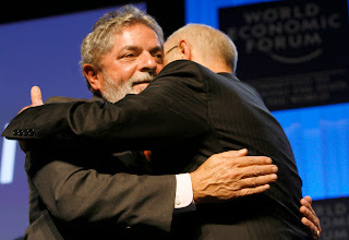 Photo: DAVOS/SWITZERLAND, 26JAN07 - Luiz Inacio Lula da Silva, President of Brazil (l) and Klaus Schwab, Founder and Executive Chairman, World Economic Forum (r), hug each other during the session 'Latin american future' at the Annual Meeting 2007 of the World Economic Forum in Davos, Switzerland, January 26, 2007.   Copyright by World Economic Forum    swiss-image.ch/Photo by Monika Flueckiger    +++No resale, no archive+++