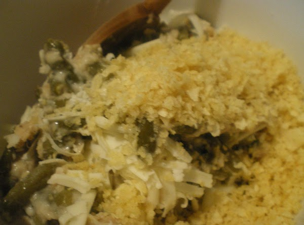In a mixing bowl combine green bean casserole, chips, and cheese.