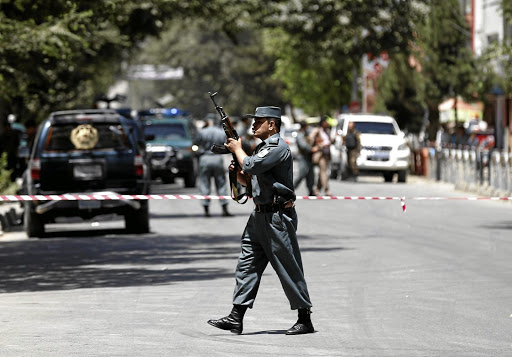 An Afghan police man stands guard at the site of attack in Kabul, Afghanistan July 31, 2017. Picture: REUTERS
