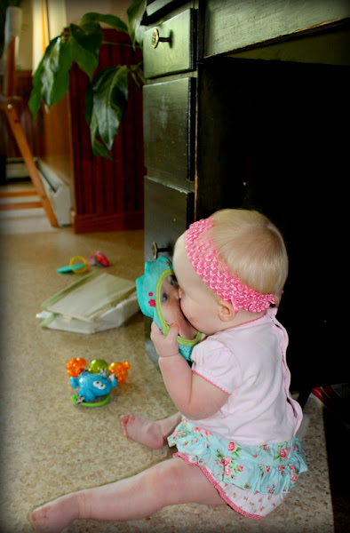Photo: Her cutest new discovery is giving kisses! Here she is kissing the baby in her play mirror.  ;)