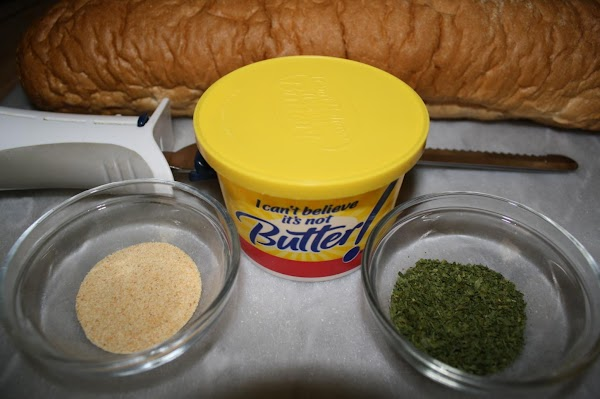 Stir the margarine until creamy.  Add garlic and parsley, and mix well. (I use...