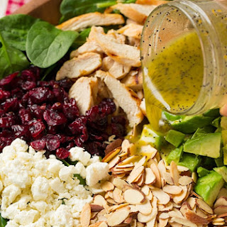 Cranberry Avocado Spinach Salad with Chicken and Orange Poppy Seed Dressing.