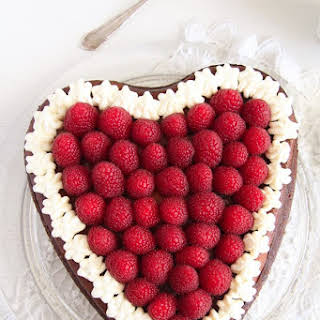 Heart-Shaped Cheesecake with Raspberries and Whipped Cream.