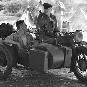 Pastime of Wartime by John Tuttle - People Professional People ( army, reenactment, tents, open shirt, weapon, wheels, motorcycle, men, smoke, gun, war, hat, military,  )