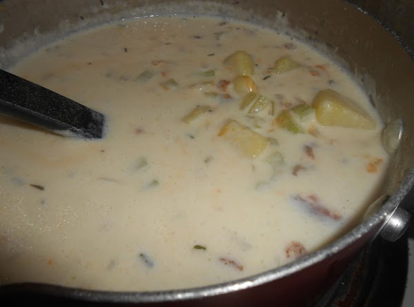 Add crumbled bacon and cheese to the soup and heat until cheese is melted...