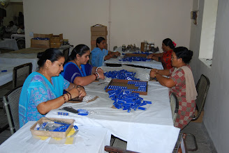 Photo: Families of inmates working in Vocational Training Workshop