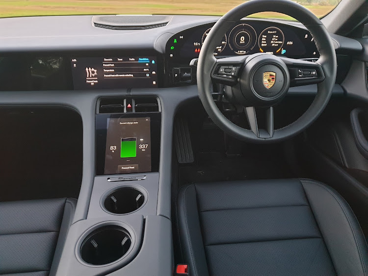 The highly digitised interior of the Porsche Taycan.