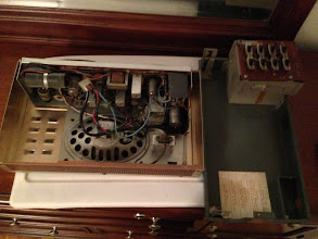Photo: We took off the back plane here, there were two scrows on the front holding it in place. On the left side of the front you can see a screw hole and what it fastens to on the bottom of the back panel.