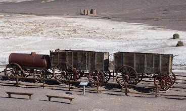 "Photo: Twenty-mule teams were teams of 18 mules and 2 horses attached to large wagons that ferried borax out of Death Valley from 1883 to 1889. They traveled from mines across the Mojave Desert to the nearest railroad spur, 165 miles away in Mojave, California. The first wagon was the trailer, the second was ""the tender"" or the ""back action"", and the tank wagon brought up the rear."