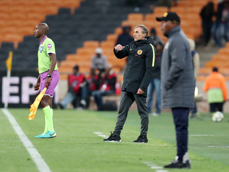 Kaizer Chiefs' Italian coach Giovanni Solinas (far left) looks on alongside his Black Leopards counterpart Joel Masutha during an Absa Premiership match at FNB Stadium in Johannesburg on November 7, 2018. Chiefs won 1-0.