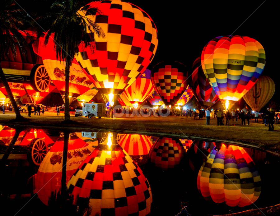 Moon Glow Refection by Tina Hailey - Transportation Other ( hot air balloon, tinas captured moments, night reflections, reflections, festival, night,  )