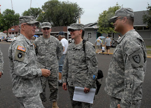 Photo: Maj. Gen. Richard Nash, Minnesota National Guard Adjutant General, was greeted by Sgt. 1st Class Melanie Nelson and Lt. Col. Kevin Olson during the Minnesota State Fair's Military Appreciation Day Aug. 30, 2011 in St. Paul, Minn.