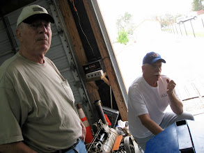 Photo: Clark Musgrove and Peter Bryan looking at Clark's loco
