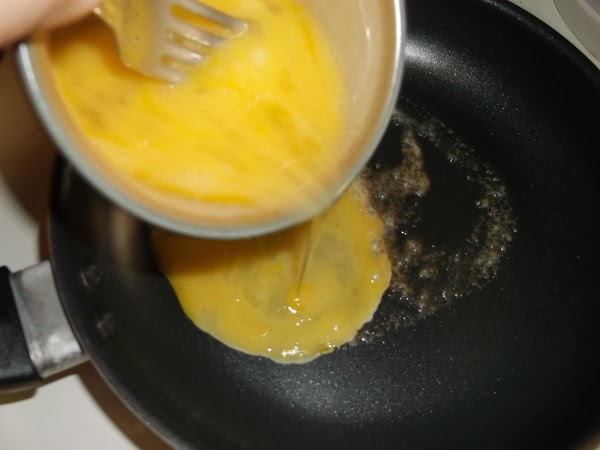 Pour eggs into skillet with melted butter; cook, stirring occasionally from bottom.