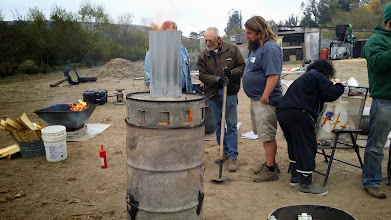 Photo: Jolly Roger Oven and pyramid kiln, burning clean.